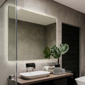 Mirror built with frosted edge back light that illuminates through the front and back.