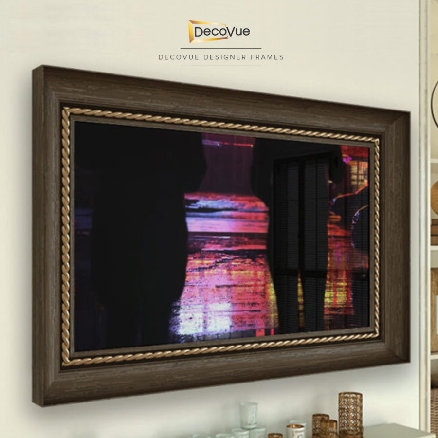 Wood frame with gold braided trim for a smart vanishing mirror TV.